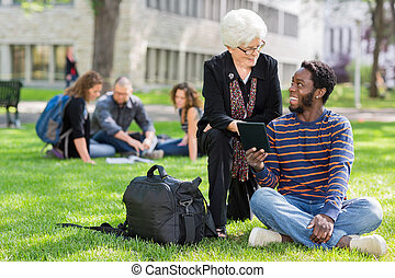 Professor and Student Working Together Outdoors