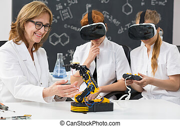 Professor and two science students wearing VR goggles