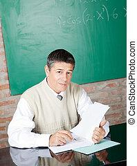 Professor at Desk