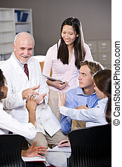 Professor having discussion with college students