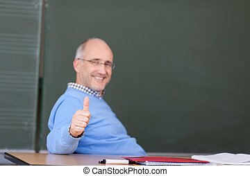 Professor Showing Thumbs Up Gesture At Desk