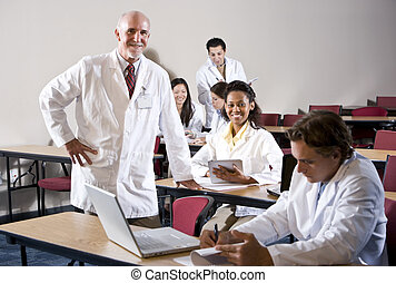 Professor with medical students in classroom - Professor...