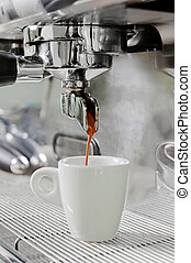 Proffesional silver gray coffee machine with white cup and pouring drink
