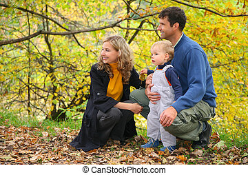 profile family with boy in autumn park