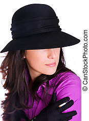 Profile of a beautiful brunette young woman with black hat, gloves and cigar