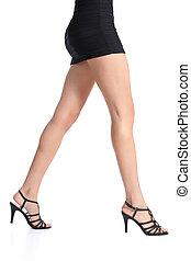 Profile of a beautiful waxing smooth woman legs walking