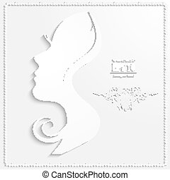 Profile of a beautiful woman cut out of paper