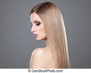 Profile of a beauty with long straight hair