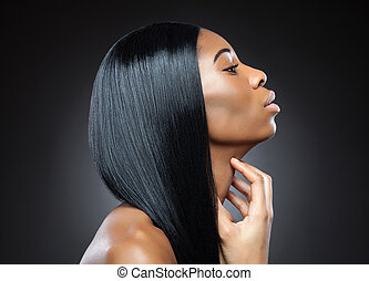 Profile of a black beauty with perfect straight hair
