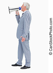 Profile of a businessman shouting with megaphone