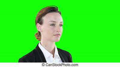 Profile of a Caucasian woman on green background - ...