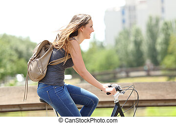 Profile of a happy woman on a bicycle