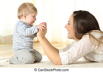 Profile of a mother and her kid son holding hands