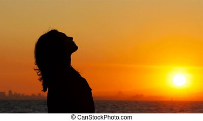 Profile of a woman breathing fresh air at sunset - Profile...