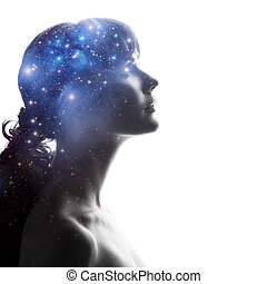 Profile of a woman with the cosmos as a brain. The ...
