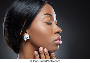 Profile of an young black beauty with perfect skin