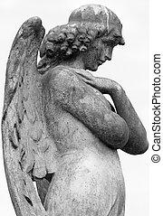 profile of antique angelic statue on italian cemetery