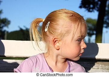 Profile of beautiful little girl