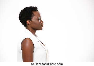 Profile of beautiful serious african american woman with short haircut