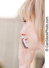 Profile of blonde with mobile