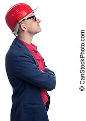 profile of Engineer with hard hat looking up