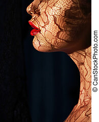 Profile of Futuristic Woman's Face with Openwork Lace in...