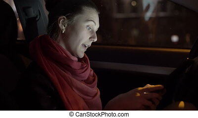 Profile of girl sitting in the car and using a tablet, 4K