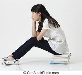 profile of girl sitting