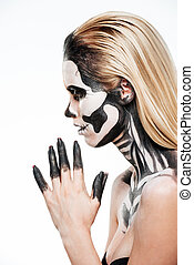 Profile of girl with terrifying halloween makeup