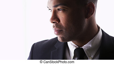 Profile of handsome black man wearing a suit