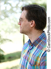 Profile of  man outdoors