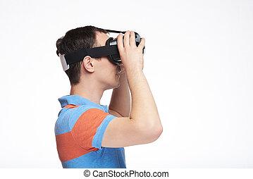 Profile of man using VR glasses