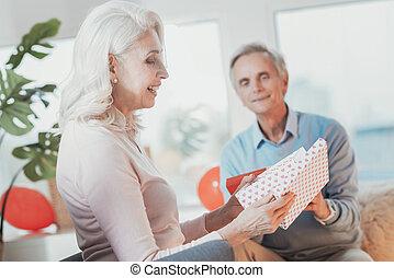 Profile of optimistic elderly lady enjoying her present