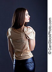 Profile of sensual young woman posing in studio
