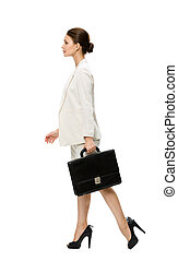Profile of walking business woman with black case