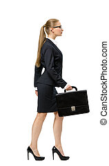 Profile of walking business woman with case