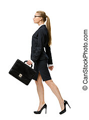 Profile of walking business woman with suitcase