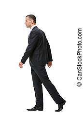 Profile of walking businessman