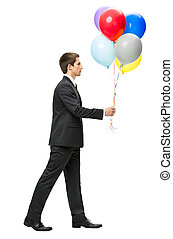 Profile of walking with balloons business man