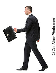 Profile of walking with black case business man
