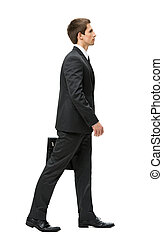 Profile of walking with case businessman