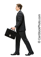 Profile of walking with suitcase business man