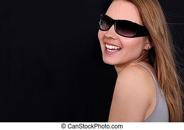 Profile of woman wearing sunglasses