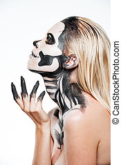 Profile of woman with intimidating halloween makeup over...
