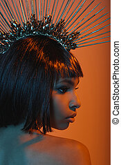 profile of young african american girl in gorgeous headpiece with needles