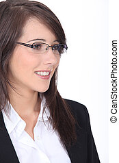 Profile of young brunette office worker