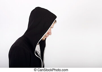 Profile of young man in black hoodies looking away