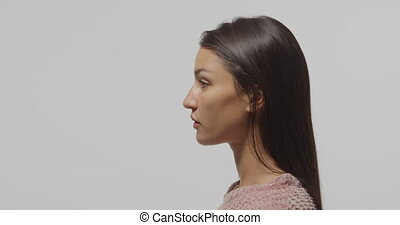 Profile of young woman - Side view close up profile of a ...