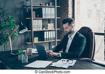 Profile photo of attentive business brunet guy looking notebook table communicating colleagues reading email letters wear blazer shirt suit sitting chair office indoors