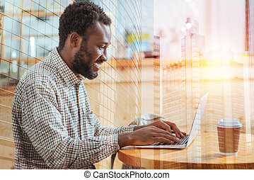 Profile photo of attentive man that typing email
